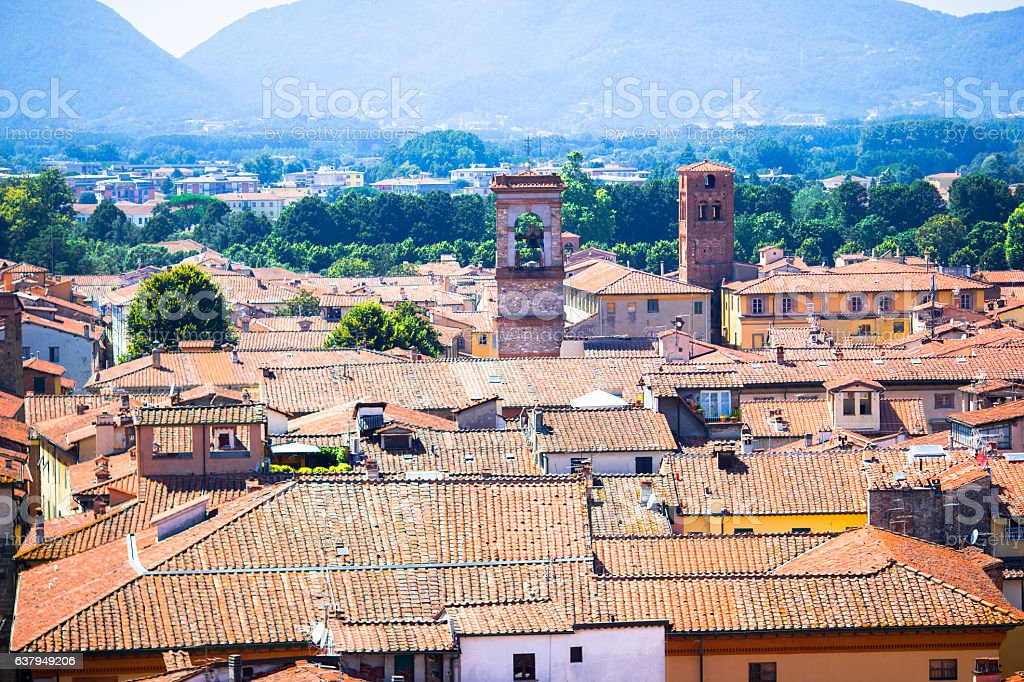View over italian town Lucca with typical terra-cotta roofs. stock photo