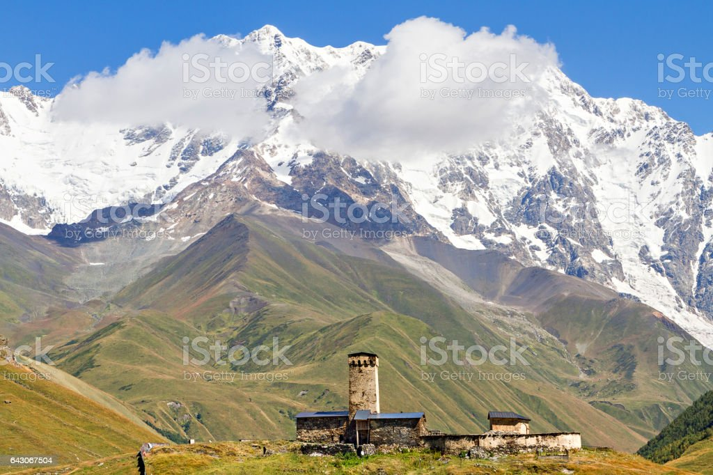 View over one of the peaks of the Caucasus Mountains, Mt Shkhara, in Ushguli, Georgia. stock photo