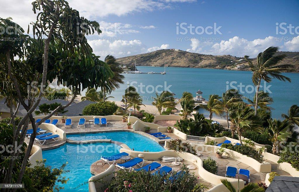 View over swimming pools and bay at Caribbean resort royalty-free stock photo