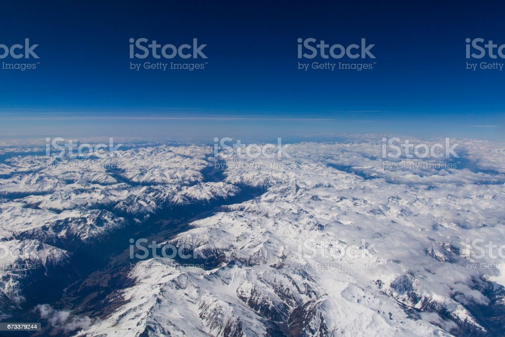 View over the alps in europe in spring in clear weather with blue skies. stock photo