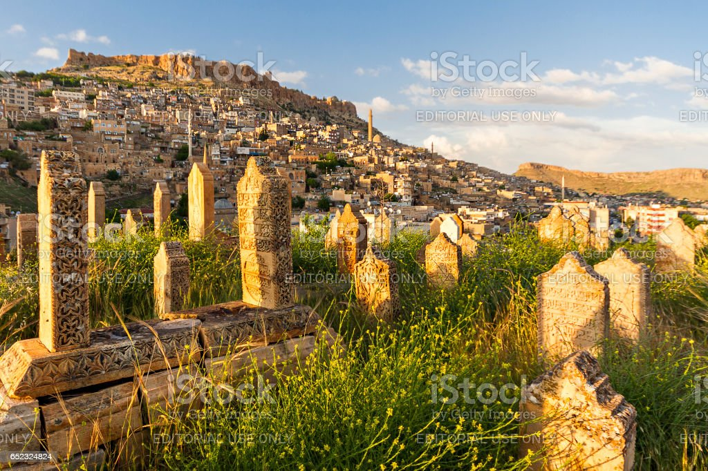 Mardin, Turkey - May 14, 2013: View over the city and the castle from old cemetery, in Mardin, Turkey stock photo