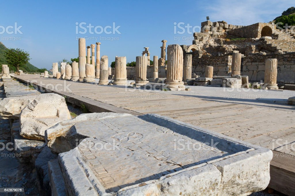 View over the columns and a roman marble gameboard in the ruins of Ephesus. stock photo