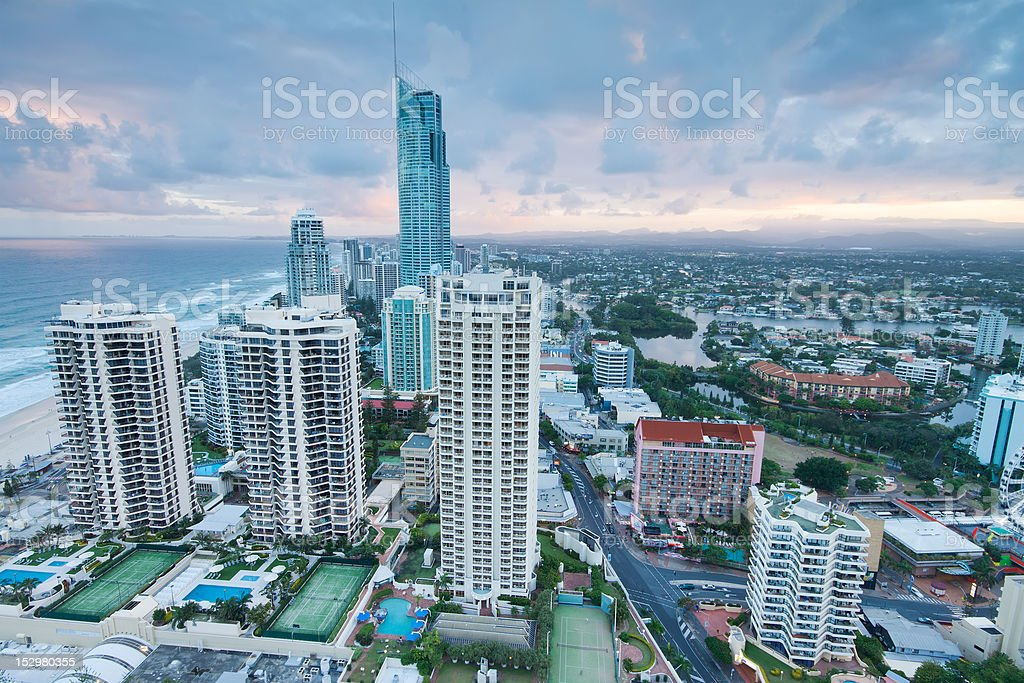 view over the modern city at twilight with ocean beside royalty-free stock photo