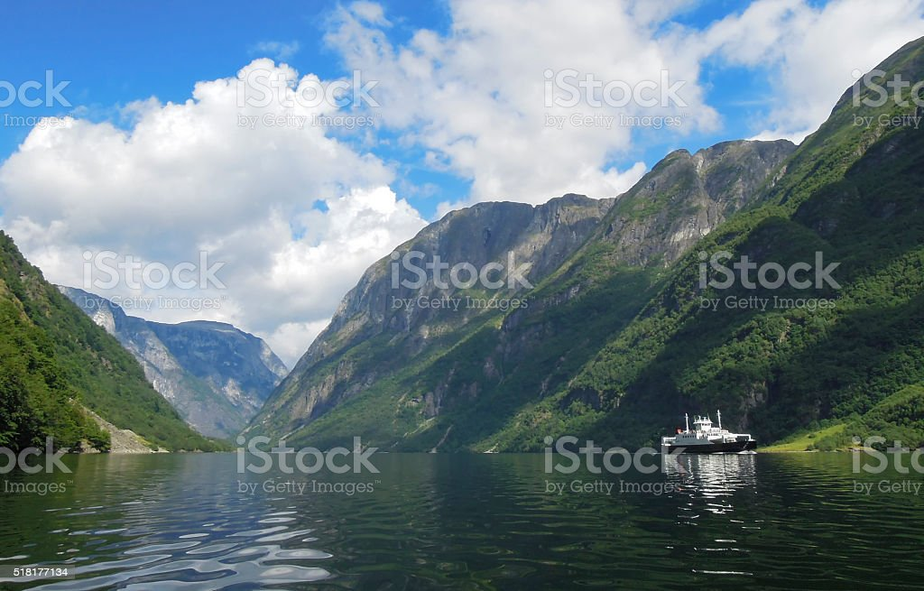 View over the Naeroyfjord with a ferry passing by stock photo