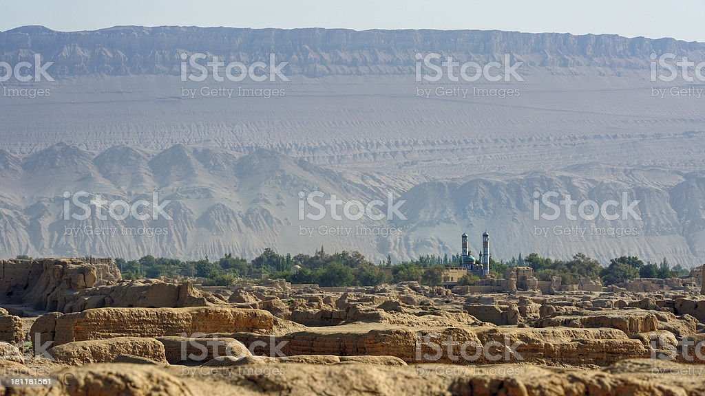 View over the rmains of Gaochang with mountains and mosque. stock photo