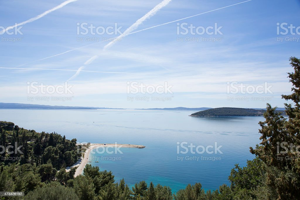 View over trees, beach, islands and calm sea stock photo