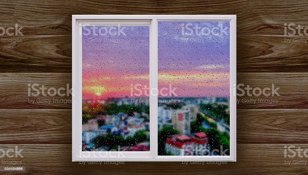 View the window of the bedroom cityscape sunset stock photo