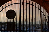 view  through a metal gate at the evening