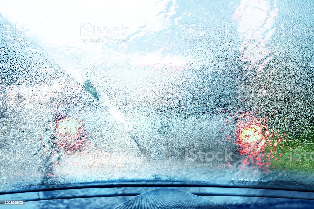 view through a rainy window on freeway stock photo