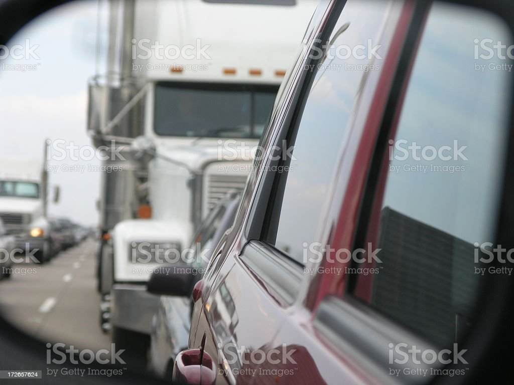 View through a rear-view mirror of vehicles in gridlock royalty-free stock photo