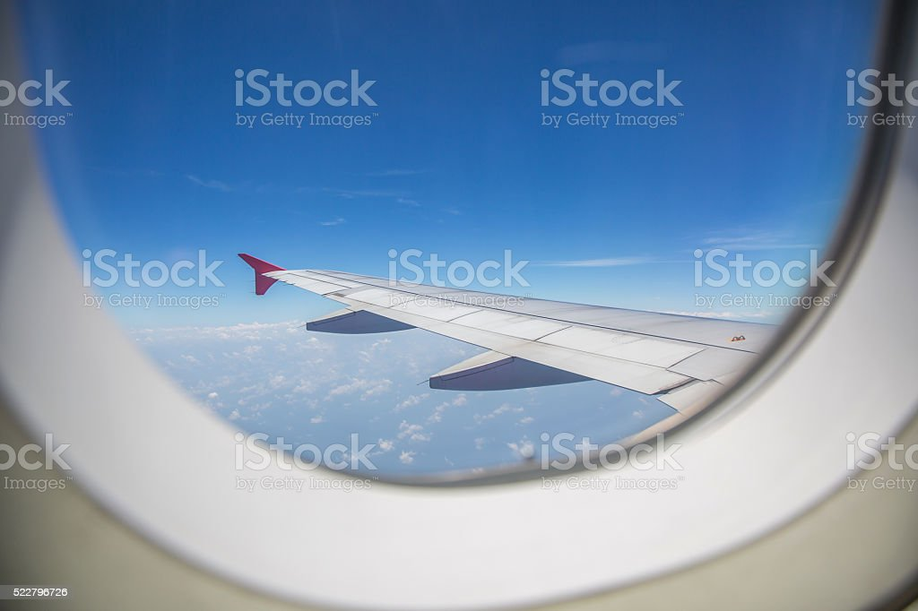 View through a window of an left airplane wing aircraft. stock photo