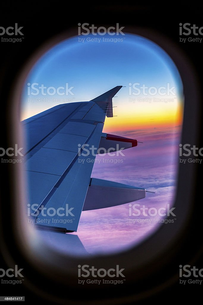 View through aircraft window onto the wing on comercial airplane royalty-free stock photo