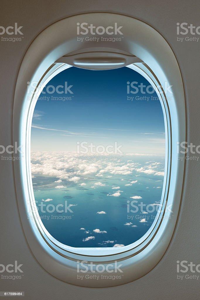 view through airplane window stock photo