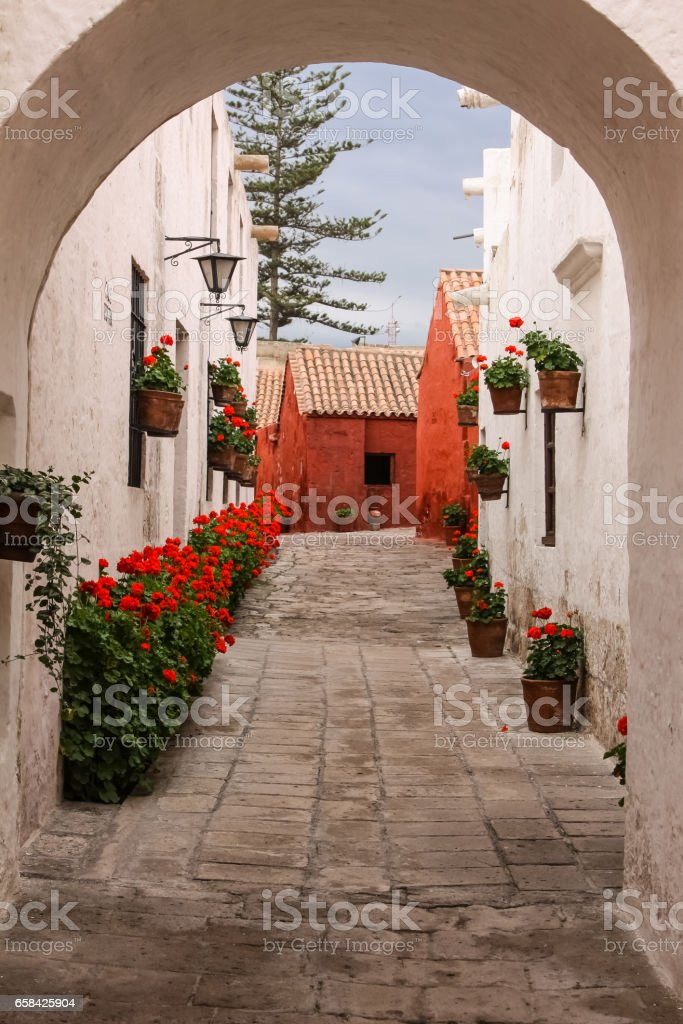 View through an arch to typical street and buildings in historic Santa Catalina Monastery, Arequipa stock photo