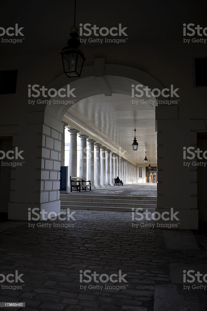 View through archway Into light stock photo