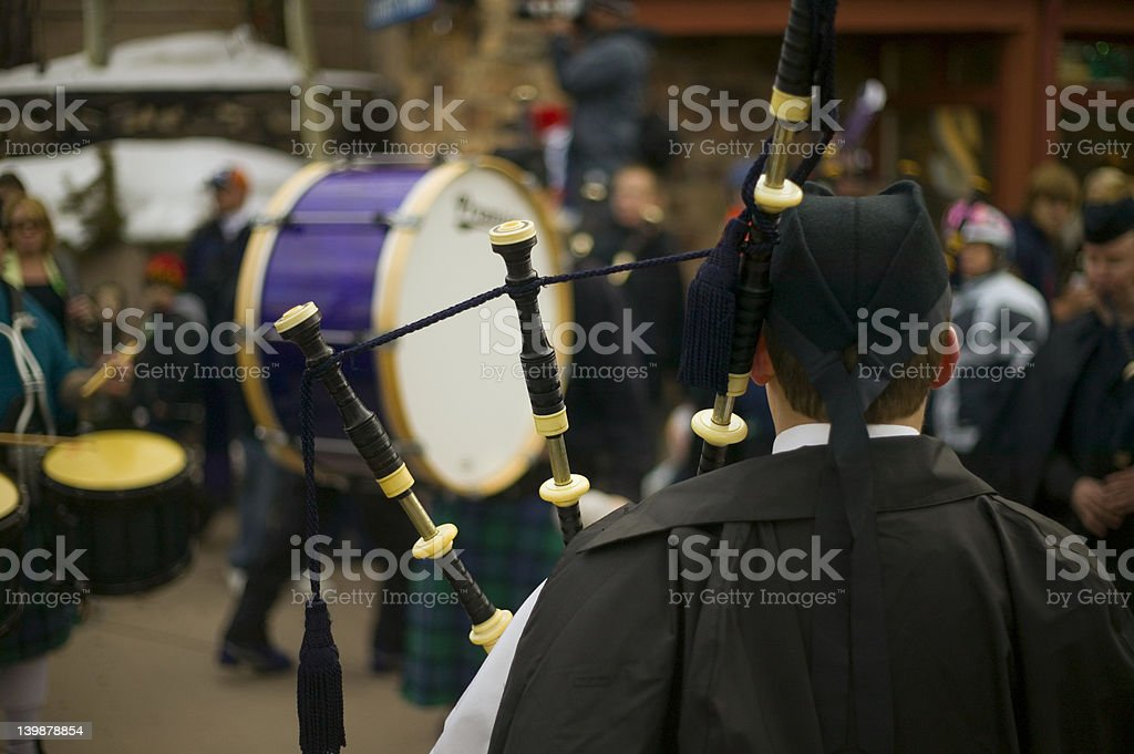 view through bagpipes to a drummer stock photo