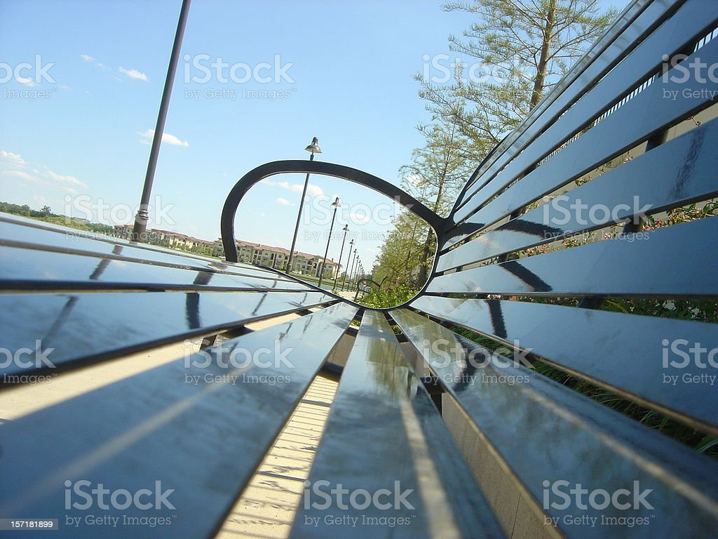 View through bench at public park royalty-free stock photo