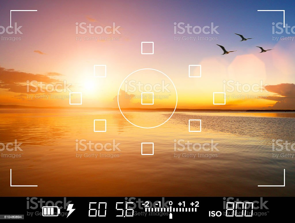 View through camera viewfinder, photographing a sunset stock photo