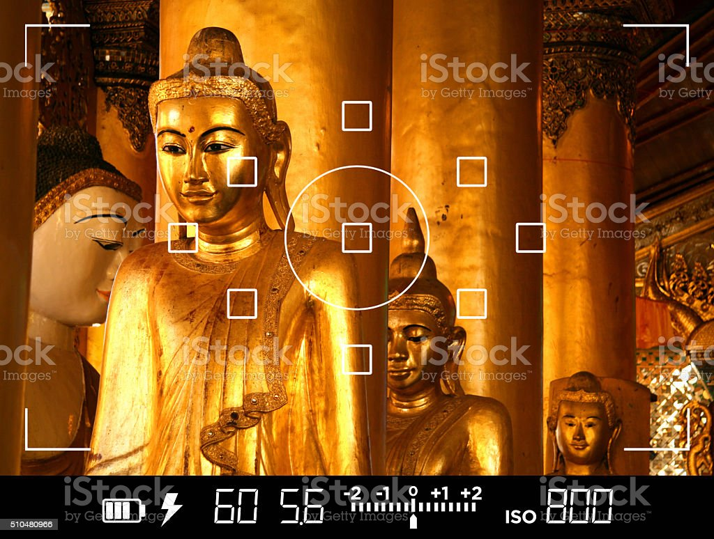 View through camera viewfinder, photographing Buddha statues in Asia stock photo
