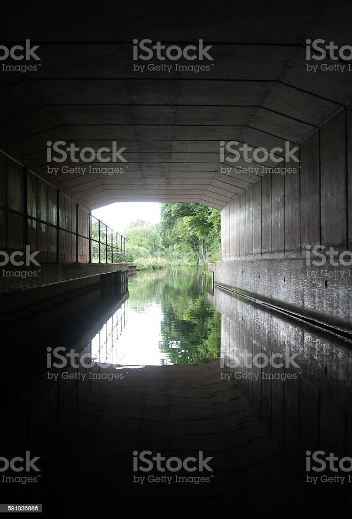 view through canal tunnel stock photo