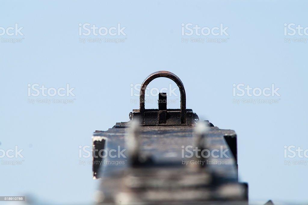 view through the fly-caliber machine gun military stock photo
