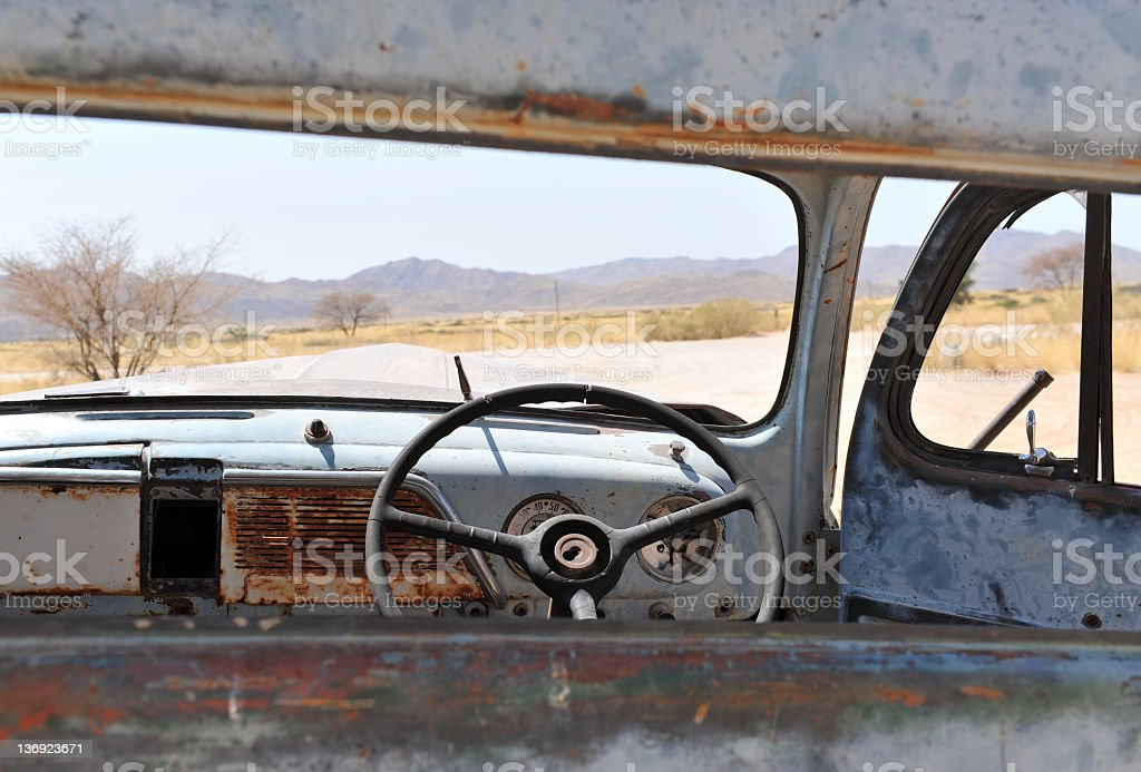 View through the rear windshield of  an old rusted car. royalty-free stock photo
