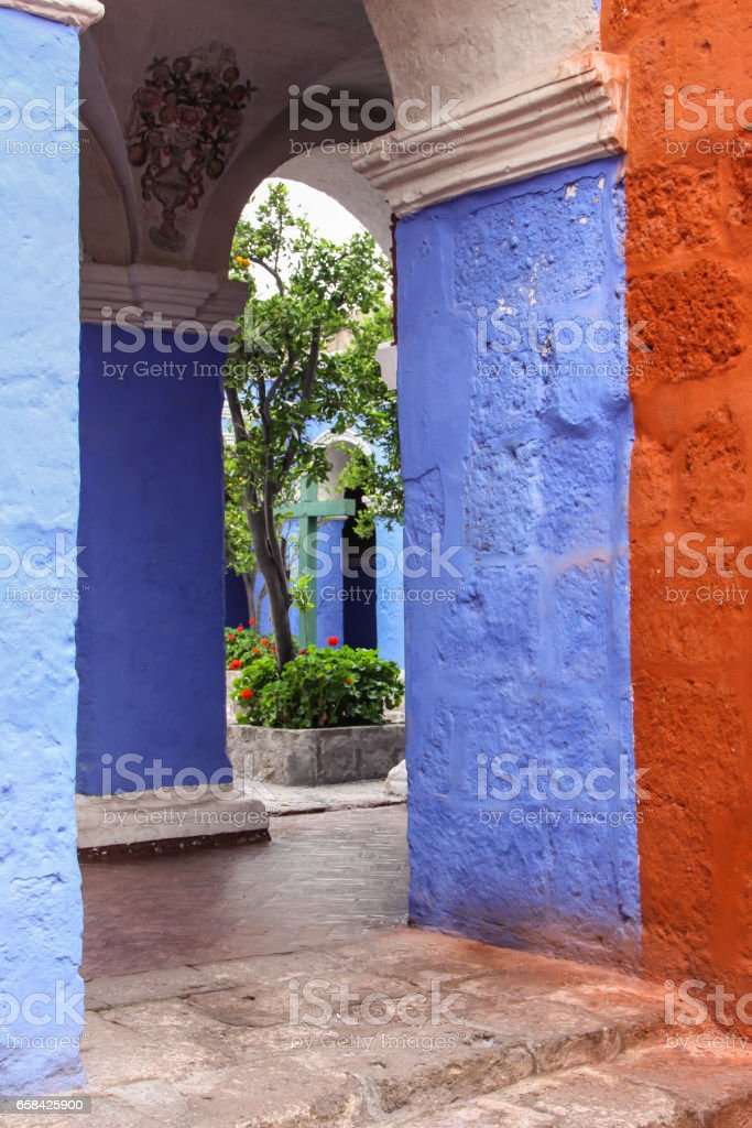 View through to an patio with plants in historic Santa Catalina Monastery, Arequipa stock photo