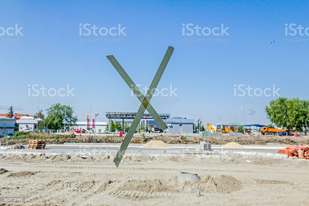 View through wide showcase on construction site with pieces . stock photo