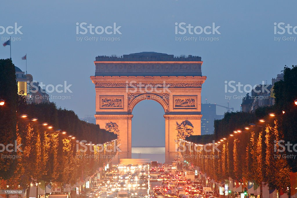 View to Arc de Triomphe over traffic on Champs Elysee, Paris royalty-free stock photo