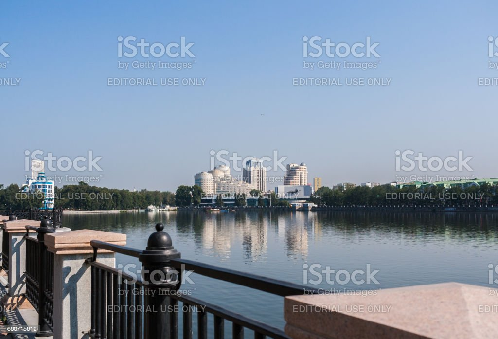 Yekaterinburg, Russia - August,04,2016: View to city center Yekaterinburg and Iset river in summer morning. View from opposite bank of river. stock photo