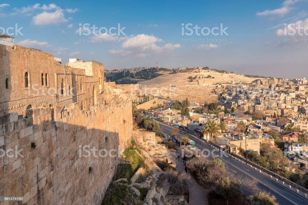 View to city wall and Jerusalem Old city at sunset. stock photo