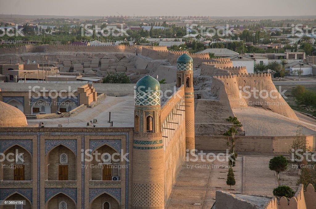 View to city walls and madrasah of Khiva, Uzbekistan stock photo