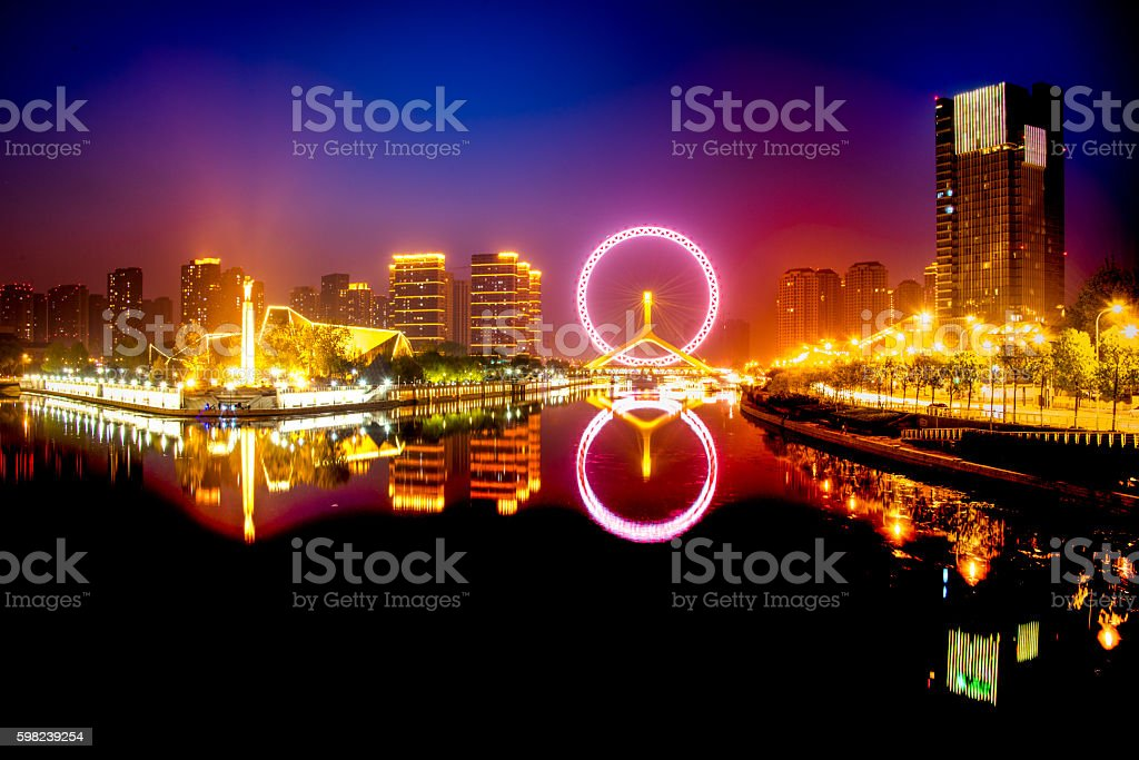 View to Eye of Tianjin at night stock photo