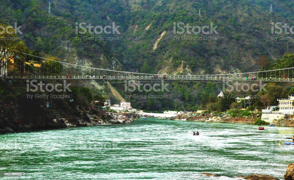 RISHIKESH, INDIA - view to Ganga river and lakshman jhula bridge stock photo