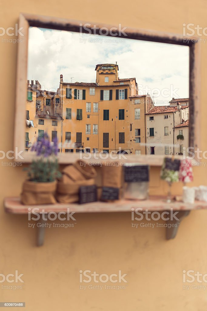 view to Piazza Anfiteatro lucca through a mirror stock photo