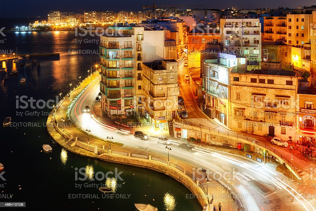 View to Sliema district over Spinola Bay shore stock photo