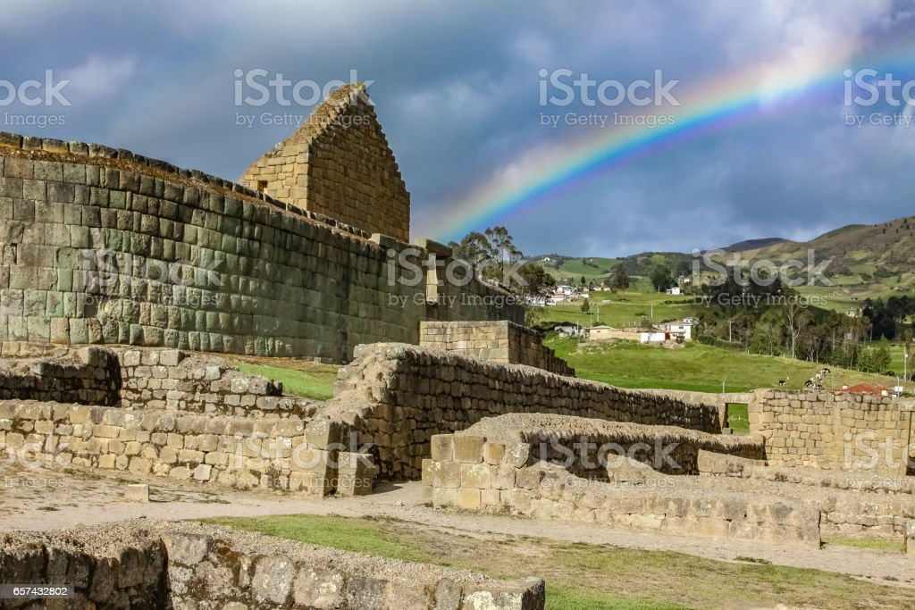 View to Temple of the Sun with rainbow, famous Inca ruins of Ingaprica stock photo