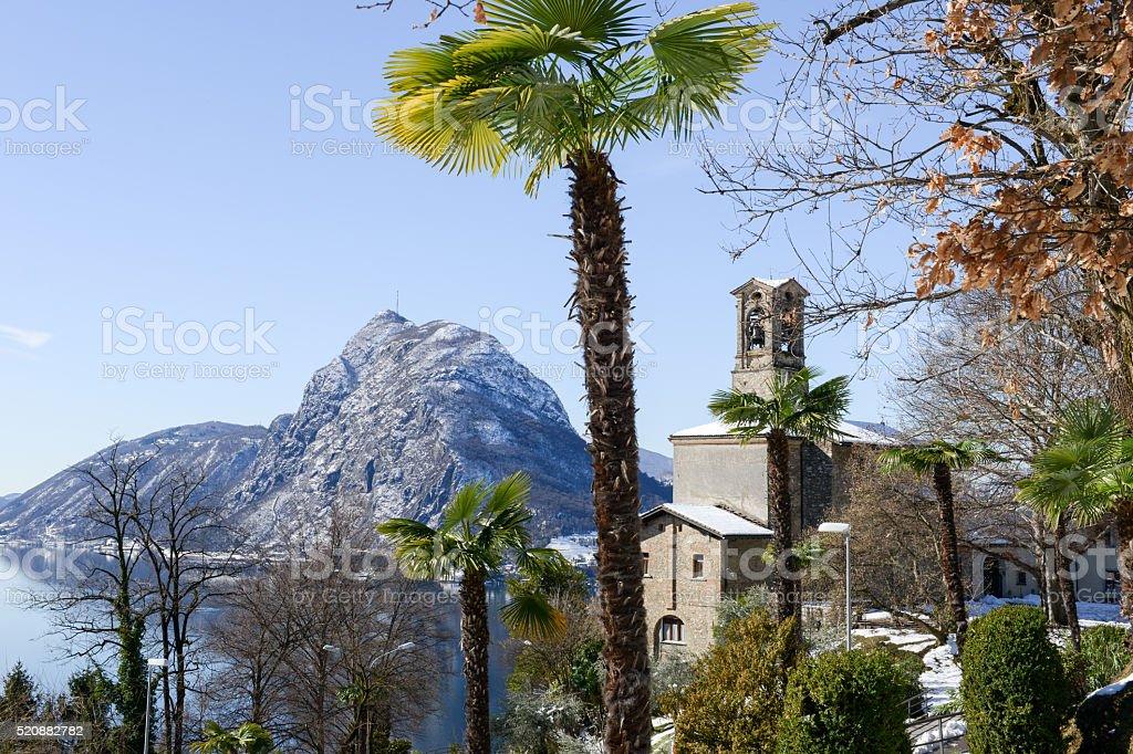 View to the bay of Lugano and Saint Giorgio church stock photo