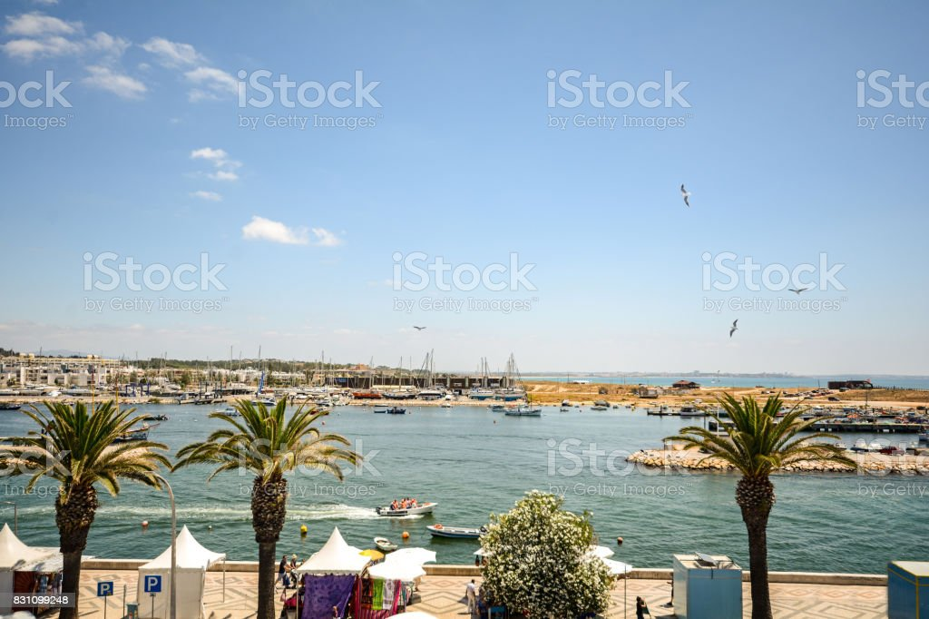 View to the coastline with waterfront - beach promenade and marina of Lagos, Algarve Portugal stock photo