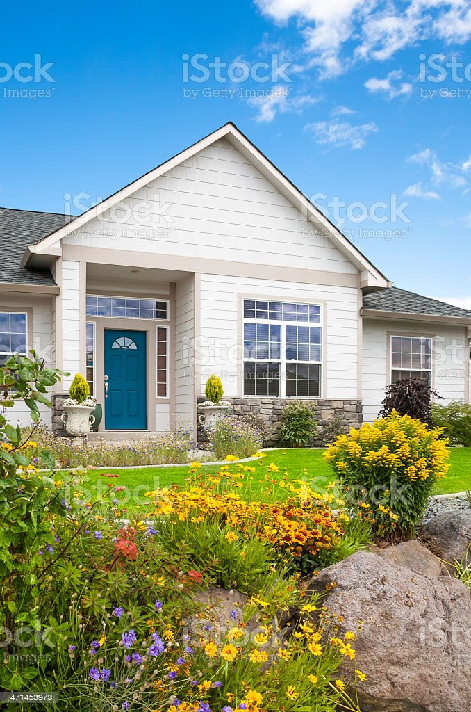 A view to the front door of a house across their garden stock photo