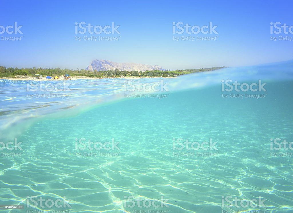 View to the sandy beach half under water stock photo