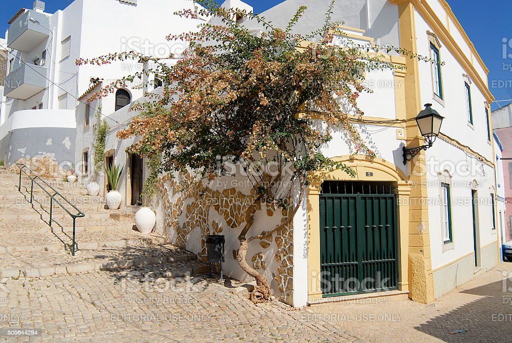 View to the street with white buildings in Estoi, Portugal. stock photo