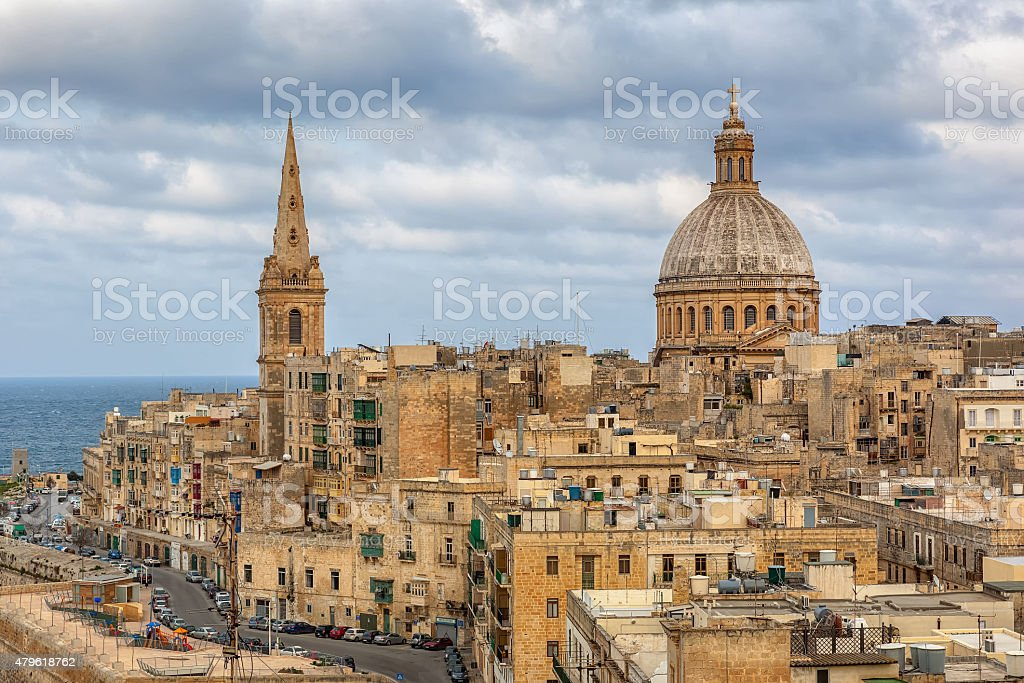 View to Valetta city buildings under clouds stock photo