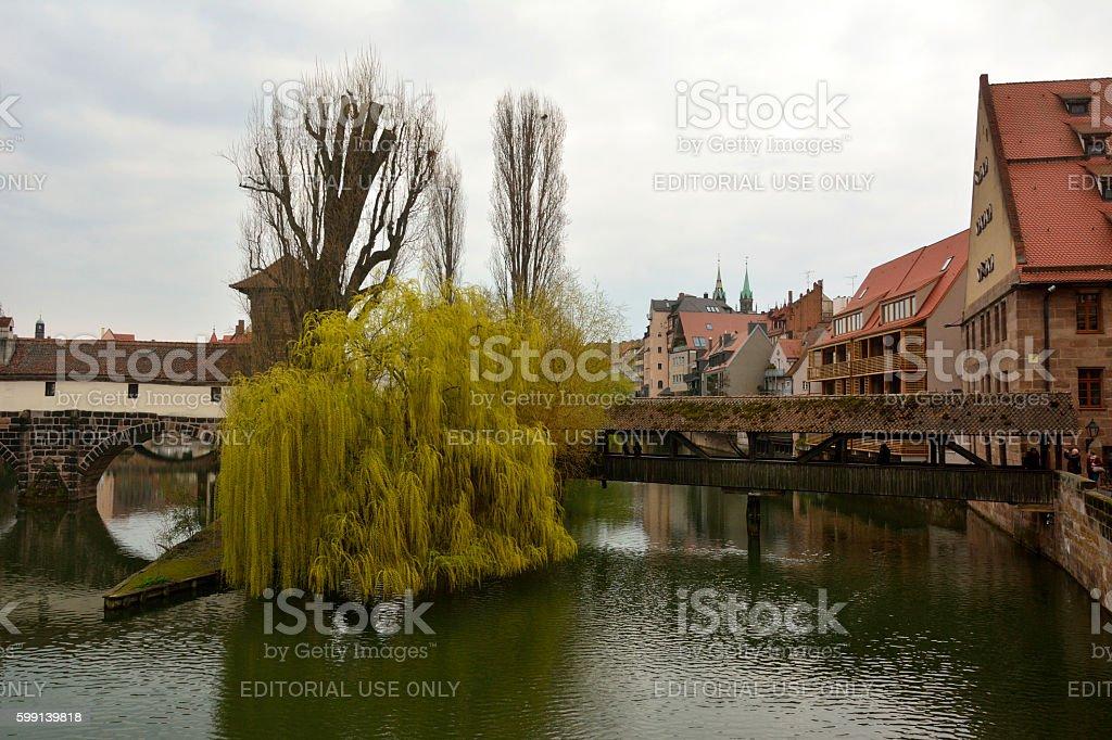 View towards Henkersteg covered bridge and Trodelmarkt in Nuremberg stock photo