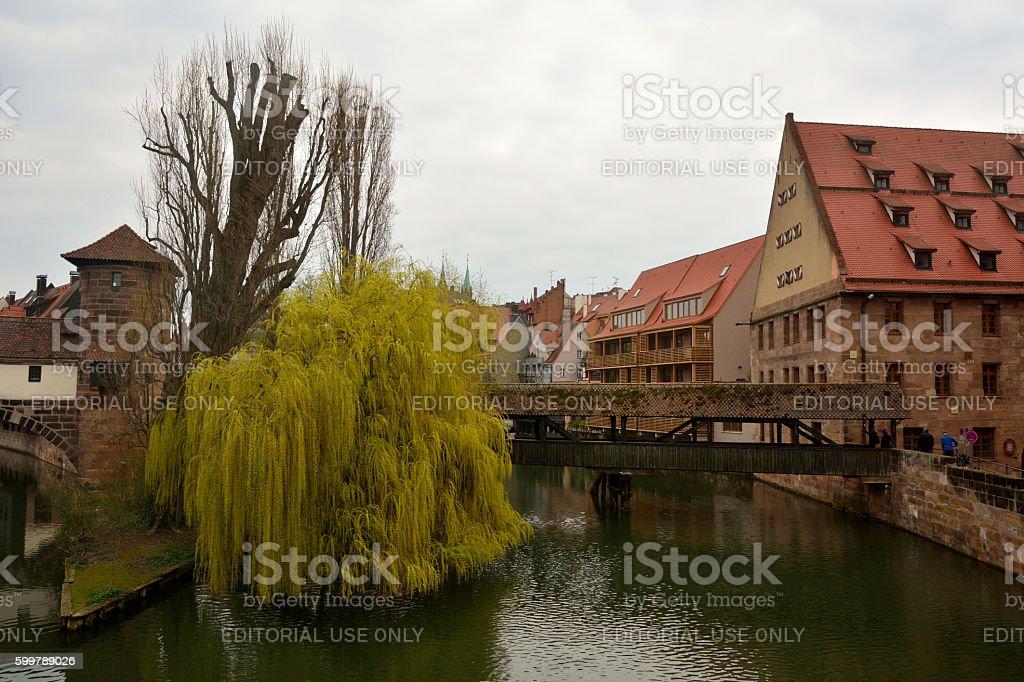 View towards Henkersteg covered bridge in Nuremberg stock photo