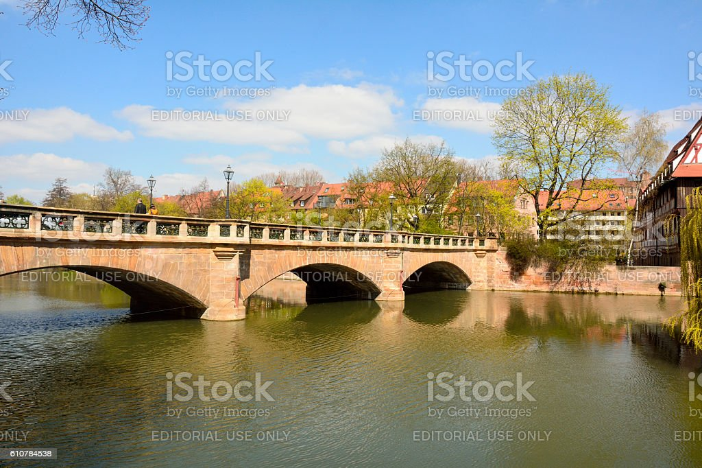 View towards Maxbrucke bridge across Pegnitz river in Nuremberg stock photo