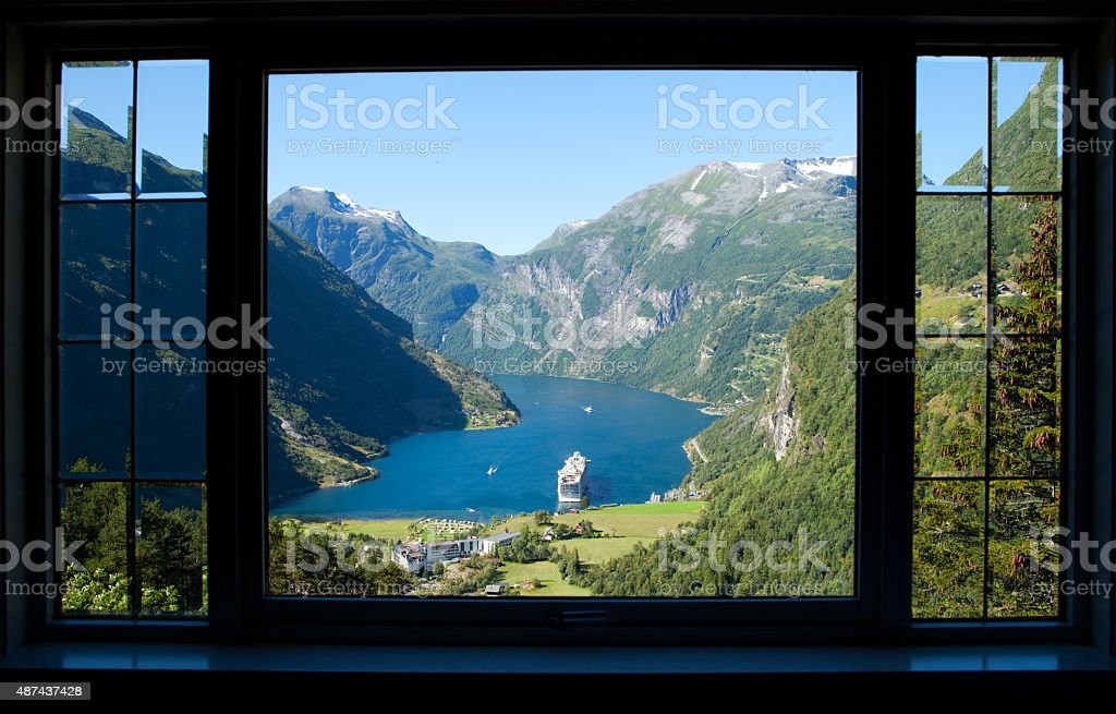 view trough a window to geiranger fjord in norway stock photo