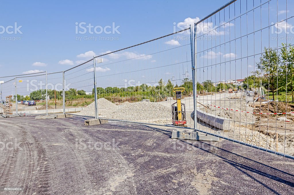 View trough mobile light metal fence on vibration plate compacto stock photo