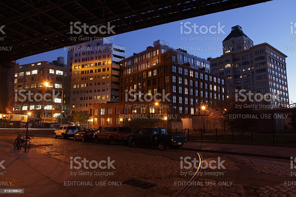 View under the Manhattan Bridge in DUMBO at night stock photo