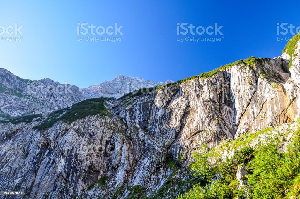 View up to Zugspitze (2962m above sea level), Germany's highest mountain, seen from Höllental, a beautiful valley hike to the summit of the mountain. stock photo